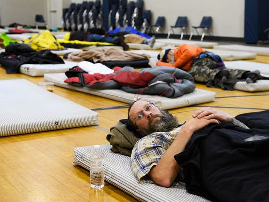 Ryan Sholes rests on a mat away from the cold weather at Miracle Hill Greenville Rescue Mission on Jan. 2, 2018. Greenville Rescue Mission opened its cold weather shelter, which can accommodate 100 individuals, to keep Greenville's homeless population safe during the cold wave, which is expected to last for the next several days.
