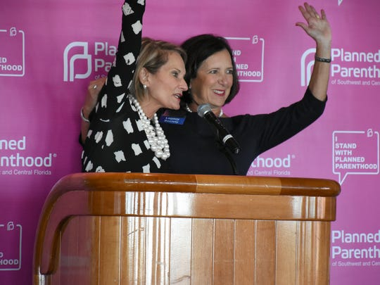 Outgoing CEO Barbara Zdravecky, left, is congratulated by Laurie Phillips, board chair, after giving a valedictory address to the crowd of supporters. National journalist Dahlia Lithwick spoke to a Planned Parenthood luncheon on Dec. 14 at the Naples Sailing & Yacht Club.