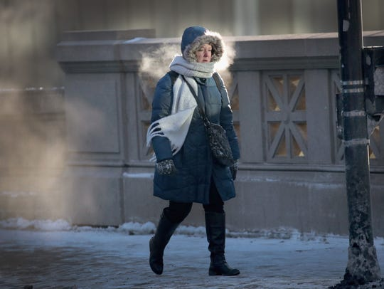 A commuter makes her way to work in sub-zero temperatures