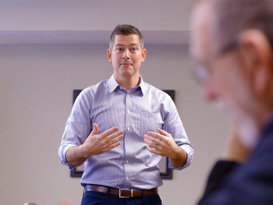 U.S. Rep. Sean Duffy, R-Wausau, speaks to his constituents during Lincoln County's town hall meeting at AmericInn Hotel Thursday, Jan. 4, 2018, in Merrill, Wisc.