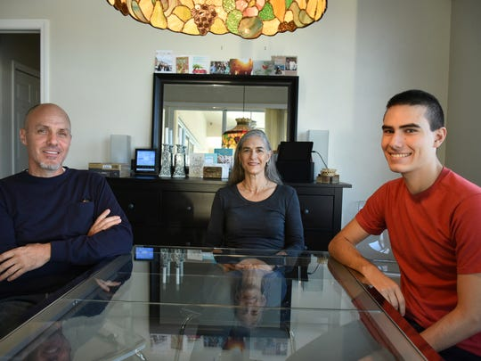 Ulysses Bunten with dad William and mom Elizabeth at home on Marco Island. Ulysses, a home-schooled student, scored a perfect score on the ACT college entrance exam.