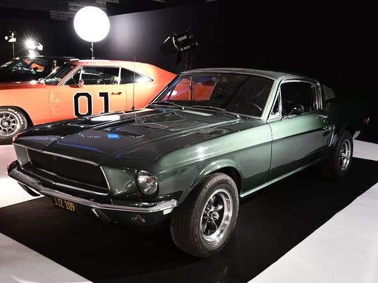 """The Ford Mustang GT 390 car used for Steve McQueen film """"Bullitt"""" is on display during the Paris Motor Show in Paris on October 1, 2016."""