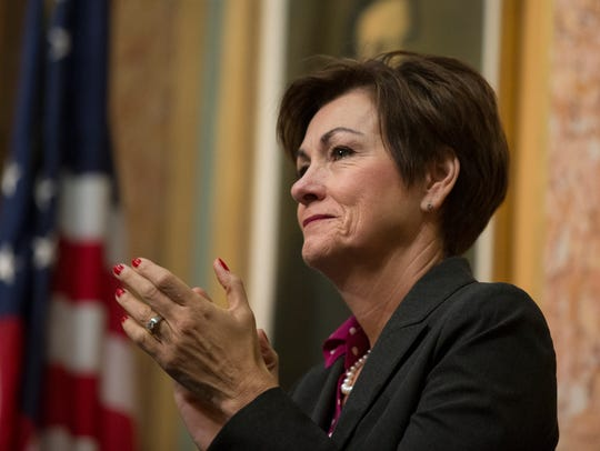 Iowa Governor Kim Reynolds applauds during the 2018