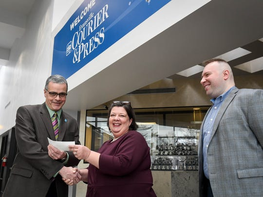 George Spohr (right) and Kelly Claycomb (left) with the Evansville Courier & Press, present Brian Holtz, representing the Evansville Parks Foundation, a check for $4050.00 for the new Kid's Kingdom Thursday, January 11, 2018.
