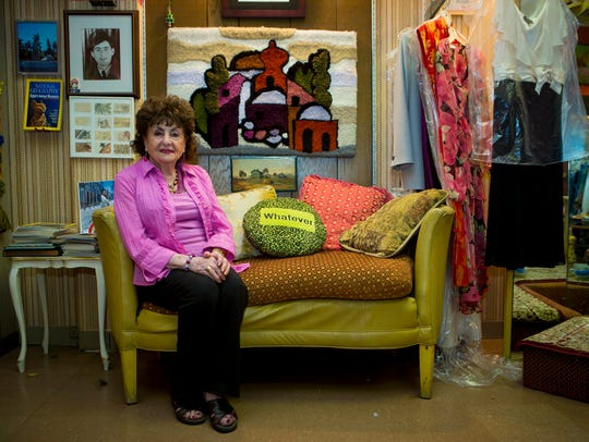 1. Sonia on her love seat in her shop, John's Tailoring,