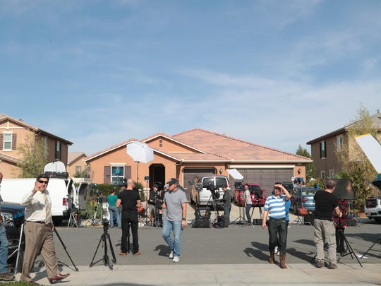 Media gathers outside of the home where David and Louise