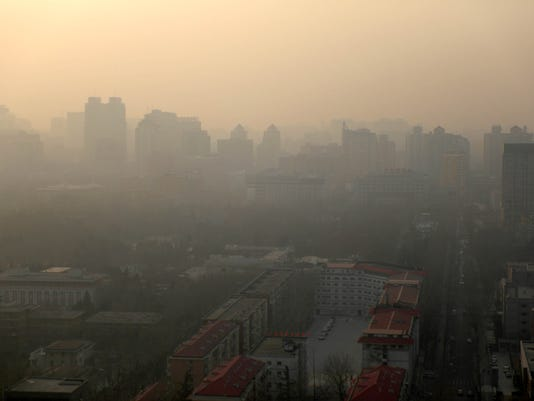 Beijing issued an orange alert for smog, its first major alert this winter, China - 13 Jan 2018