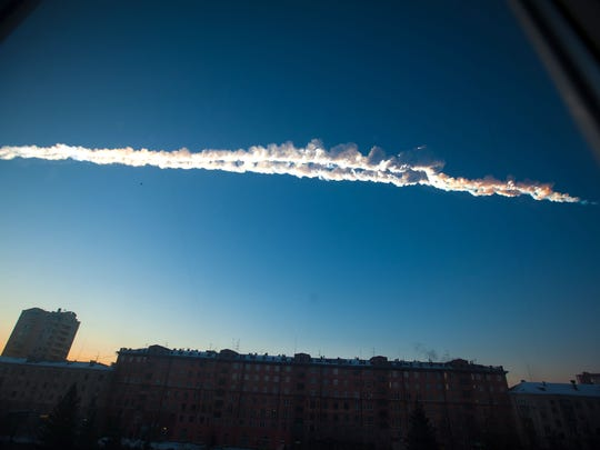 In this photo provided by Chelyabinsk.ru, a meteorite contrail is seen over Chelyabinsk, Russia on Feb. 15, 2013.