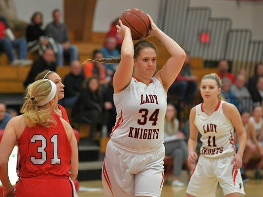 Abi Giese (34) of Lourdes passes to a teammate. The Lourdes Academy Lady Knights hosted the Hustisford Falcons in a Trailways East Conference matchup Thursday evening, January 18, 2018.