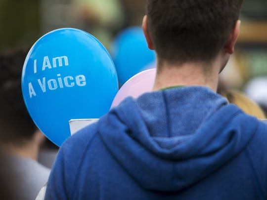 """Balloons with """"I Am A Voice"""" on them were ubiquitous"""
