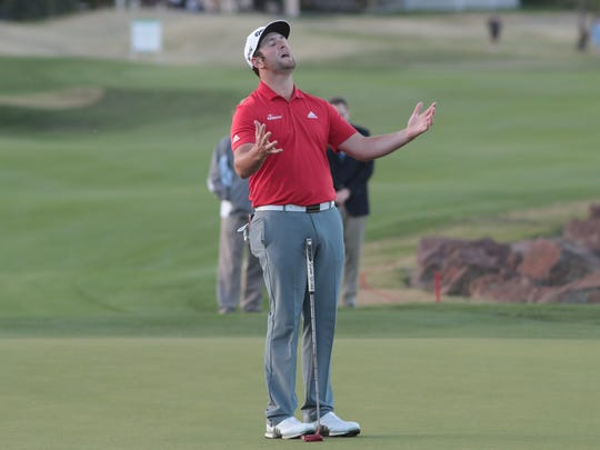 Jon Rahm reacts after missing a putt in his second