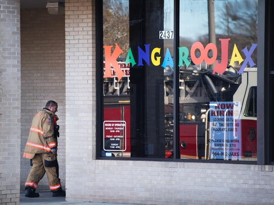 Firefighters work on scene of a fire at Kangaroo Jax on Laurens Road in Greenville on Tuesday, January 23, 2018.