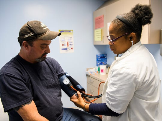 Scottie Pitts has his blood pressure checked by patient care technician Malinda Cosby at the Greenville Free Medical Clinic on Thursday Jan. 25, 2018.