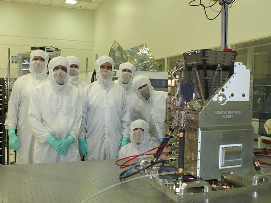 Members of NASA's GOLD mission science team gathered with the instrument at the University of Colorado's Laboratory for Atmospheric and Space Physics on Dec. 1, 2016, before the instrument was shipped to Toulouse, France, for integration with the SES-14 statellite.