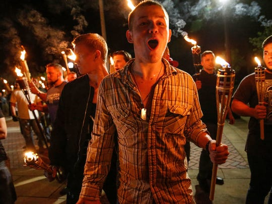 Mykal McEldowney/IndyStar Multiple white nationalist groups march with torches through the University of Virginia campus in Charlottesville on Friday, Aug. 11. Multiple white nationalist groups march with torches through the University of Virginia campus in Charlottesville on Friday, August 11, 2017.