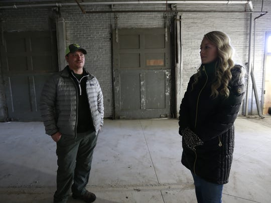 Dan Weber and his wife Kimm VanDen Heuvel, both of Wausau, take USA TODAY NETWORK-Wisconsin's reporter Laura Schulte for a tour of the formerly Wausau Train Depot building they hope to turn into a distillery Monday, Jan. 8, 2018, in Wausau, Wisc. T'xer Zhon Kha/USA TODAY NETWORK-Wisconsin