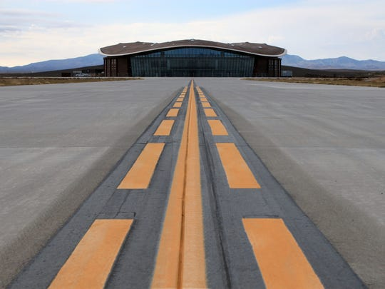 This 2014 file photo shows the taxiway leading to the hangar at Spaceport America, located in the desert 45 miles north of Las Cruces.