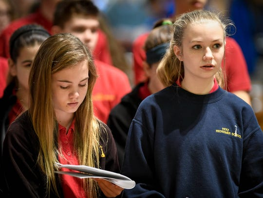 Holy Redeemer School students Lexi Kassenerock (left)