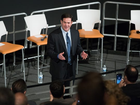 Arizona Gov. Doug Ducey and other state and business