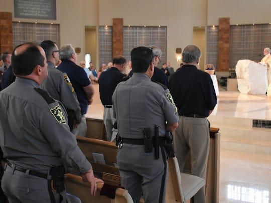 Collier deputies listen to the service. St. Agnes Catholic