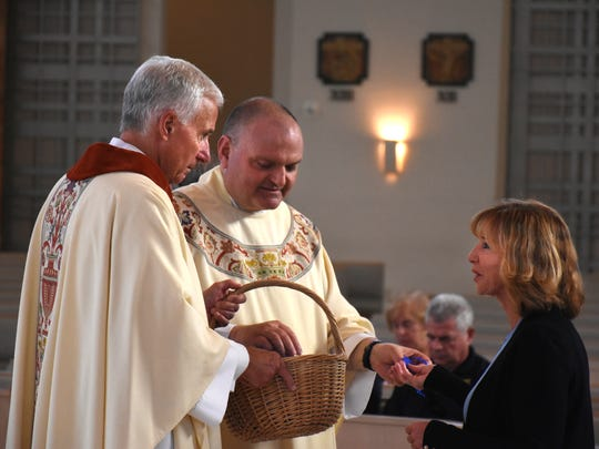 Retired Chicago Detective Cathy Burke receives communion.