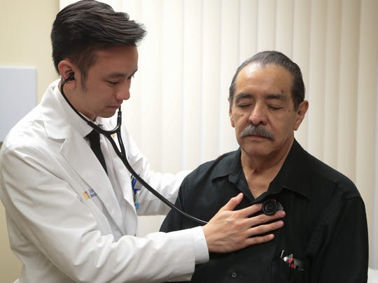 Dr. Nguyen, a third year resident in UC Riverside's Family Medicine Program, examines Antonio Ascensio, Palm Springs, Calif., February 1, 2018.