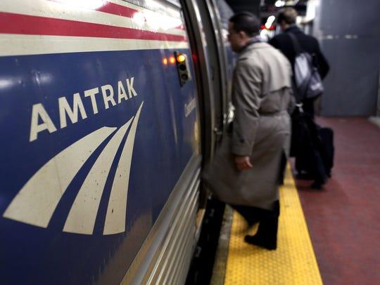 An Amtrak train at Penn Station, accessed through an