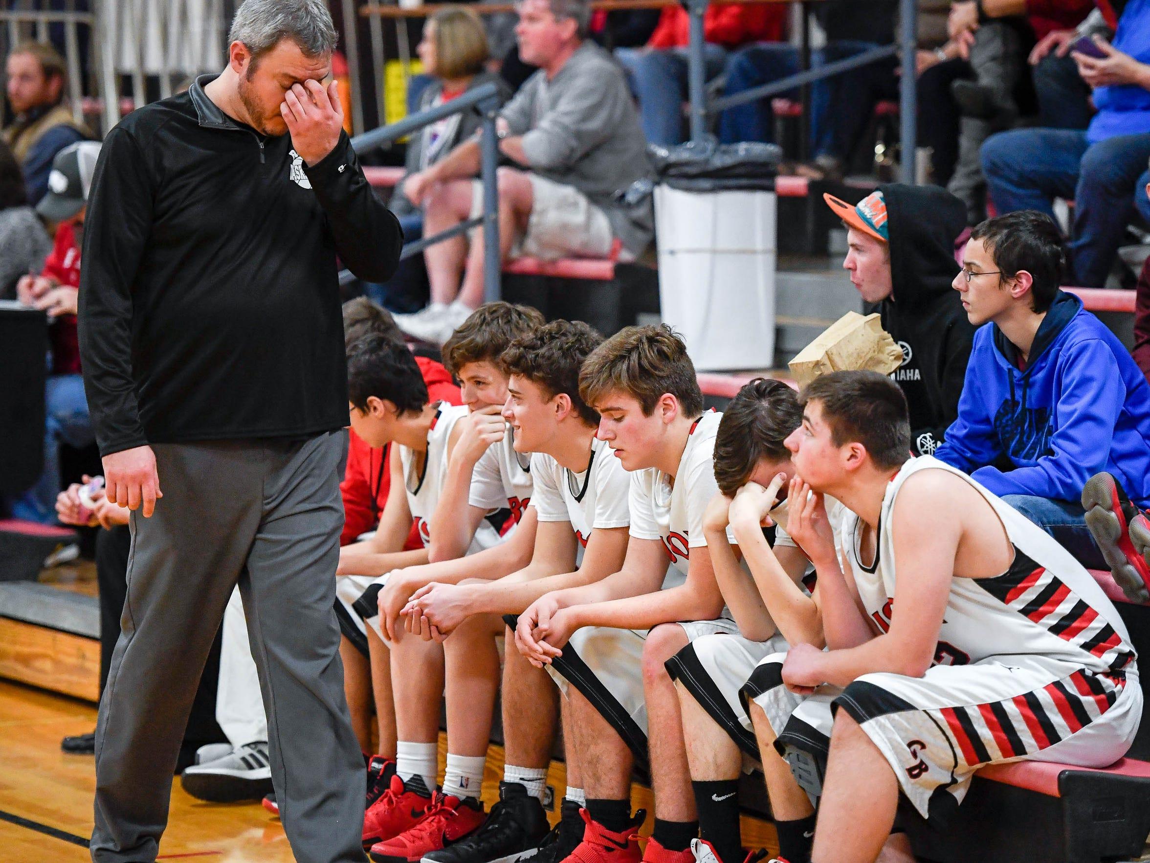 Head coach Brian Hucker and the Grayville bench as