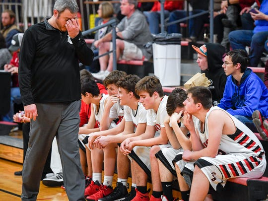 Head coach Brian Hucker and the Grayville bench as the Bison play the Woodlawn Cardinal's in Grayville Tuesday. Grayville lost to Woodlawn 86-32, January 23, 2018.