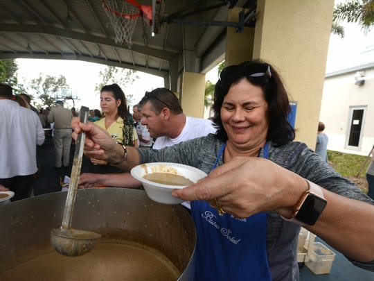 Lisa Meurgue of Bistro Soleil dishes up cream of wild mushroom soup. The Marco Island Area Chamber of Commerce held its sixth annual Souper Bowl on Saturday, raising money for scholarships while giving attendees the chance to sample soups from area eateries.