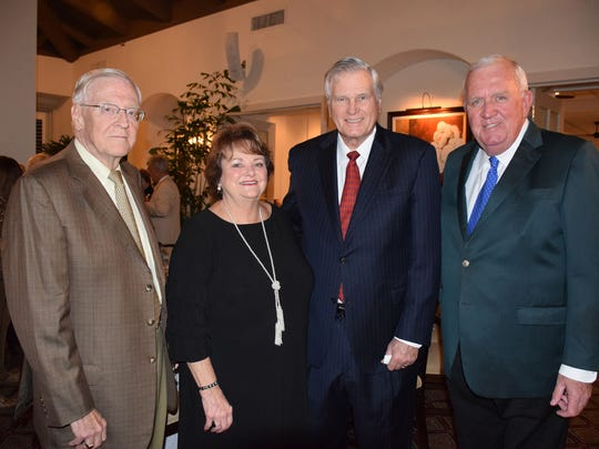 """Mel Teez, left, Jan and Mike Harrell, and Jim Kelly at Grand Harbor Golf & TennisClub for Camp Haven's """"Diamonds In The Rough"""" gala."""