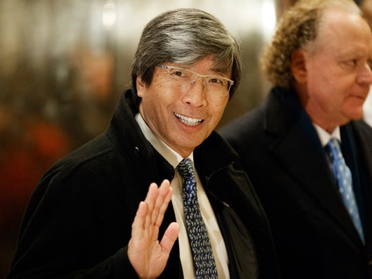 In this Jan. 10, 2017, file photo, pharmaceuticals billionaire Dr. Patrick Soon-Shiong waves as he arrives in the lobby of Trump Tower in New York for a meeting with Donald Trump.