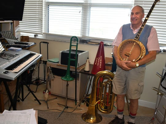 Longtime Marco Island Strummers bandleader Wes English in the music room at his beachfront condominium. English spent a lifetime juggling music and medicine.
