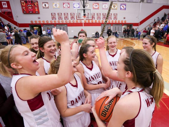 Danville players celebrate their second straight regional title after knocking off Owen Valley on Saturday.