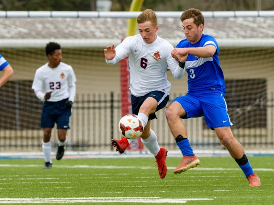 Luke Hacket battles for the ball as Teurlings Catholic
