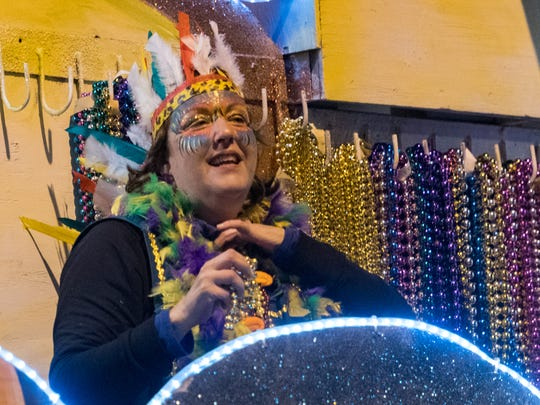 Krewe Queens ride in the Queen Evangeline Parade Monday