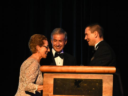 TJ Boone, right, presents the Grado Award to Ray and Louise Jean. The American Cancer Society's 2018 Imagination Ball, dedicated to the fight against cancer, took place Saturday night at the JW Marriott.