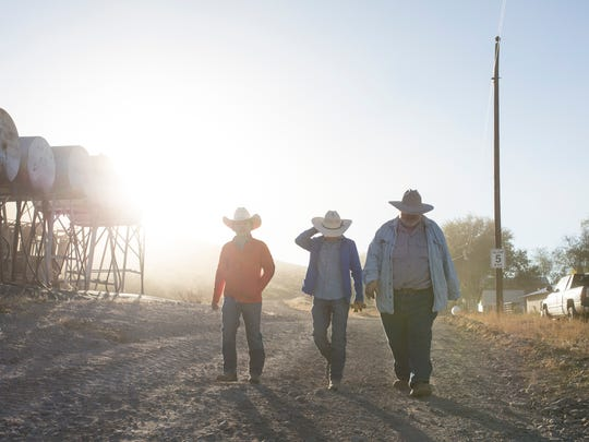 David and James Hurt walk with their father William Hurt across the ranch early one morning in the fall. The boys are being raised in the rural area of the bootheel where they ride horse, drive machinery and shoot guns.