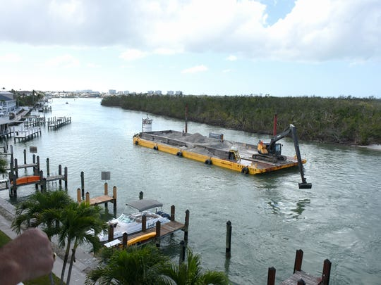 File: Collier County is dredging the entrance to Collier Creek, with the work being done on an expedited basis, to alleviate the danger to island boaters from the hurricane-damaged waterway.