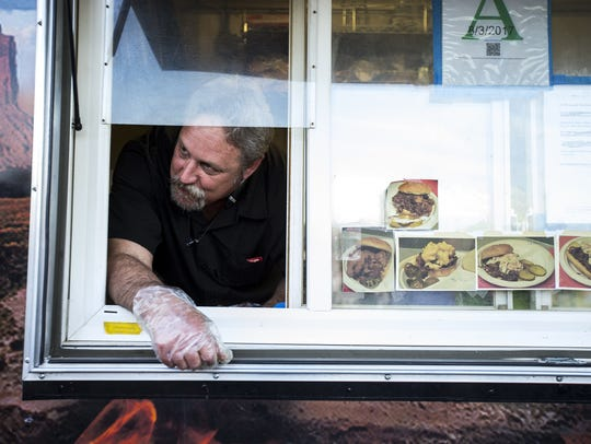Rep. Kevin Payne waits for a customer to pick up their