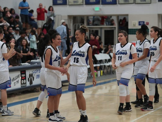 Cathedral City girls basketball celebrates after defeating