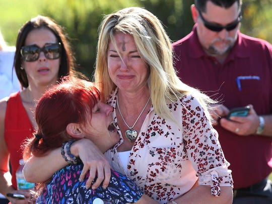 Parents wait for news after a reports of a shooting