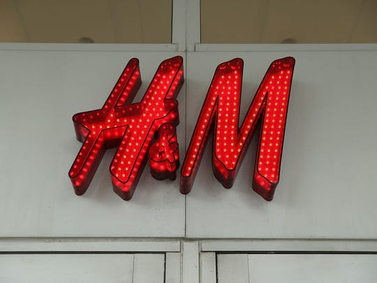 A sign is seen on a H&M clothing store on January 9,
