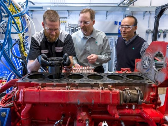 From left, Steven Sommers, senior technician, Mike Traver, commercial transport team lead and Yu Zhang, senior researcher, all of Aramco Research Center-Detroit based in Novi. Saudi Aramco is working on improving the efficiency of current and future engines, while reducing the overall environmental impact, cost, and complexity of engine systems.