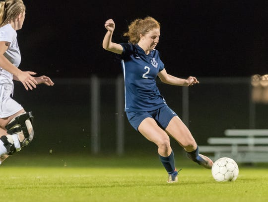 Samantha Withers moves the ball as ESA advances in
