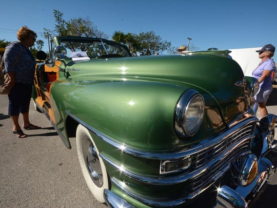 The Kiwanis car show is from 9 a.m. until 3 p.m., Feb. 16, at Veterans Community Park, Marco Island. Above, file: Carleen Lambie inspects John Kernan's 1948 Chrysler Town and Country.
