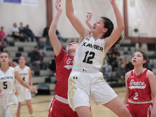 Angie Carroll shoots for Xavier Prep in a quarterfinal
