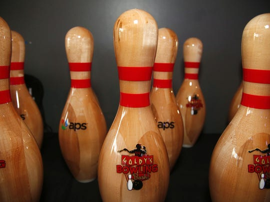 Printed bowl pins sit on a table during Goldy's Bowling Bash at Lucky Strike in Phoenix on February 22. 2018.