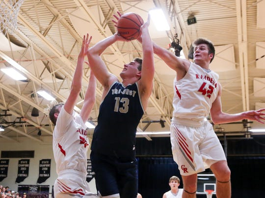 Cardinal Ritter's Nate Soltis blocks a shot from Tri-West's