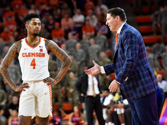 Clemson head coach Brad Brownell speaks with Clemson